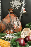 Christmas decoration. With snowflakes, small keg, garland, onion, corn and haricot beans isolated on black background Stock Photos