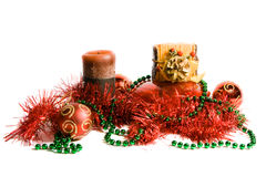Christmas decoration. Red Christmas balls, green beads and candles, isolated royalty free stock photo