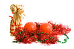 Christmas decoration. Two red candle, tinsel and tradition finnish christmas goal, isolated stock photo