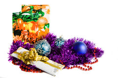 Christmas decoration. Blue christmas balls, candle, violet tinsel, gift bags and gift box, isolated royalty free stock image