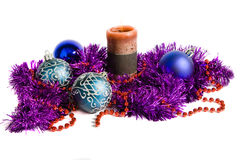 Christmas decoration. Blue christmas balls, candle, violet tinsel and gift box, isolated stock photos