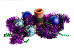 Christmas decoration. Blue christmas balls, candle and violet tinsel stock images