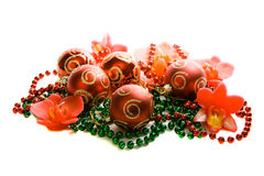 Christmas decoration. Red christmas balls, candles, green and red beads royalty free stock image