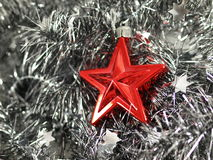 Christmas decoration. Red star with silver chain background stock images