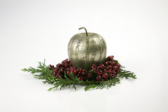 Christmas, decoration. Christmas apple made of silver on top of red berries and the Christmas tree, special seasonal holidays Stock Photo