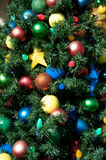 Christmas decoration. Close up of Christmas tree decorated with colorful balls ans stars Stock Image