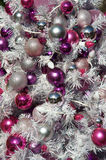 Christmas decoration. Close up of Christmas tree decorated in red, pink and white Stock Photography