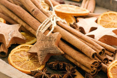 Christmas decoration. Cinnamon with dried orange slices and anise Stock Photos