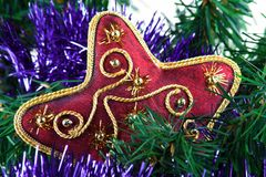 Christmas decoration. Red star on the pine close up Royalty Free Stock Image