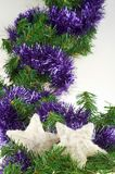 Christmas decoration. With pine, white shiny stars and blue garland Royalty Free Stock Image