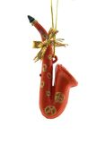 Christmas Decoration. A red saxophone is isolated on a pure white background Royalty Free Stock Images