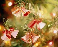 Christmas decoration. Close up of bells on a christmas tree stock photography