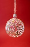 Christmas decoration. Transparent christmas decoration on bright red background Royalty Free Stock Photography