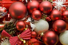 Christmas decoration. Red and silver globes on tinsel background with snowflakes pine cones christmas decorations Royalty Free Stock Photo
