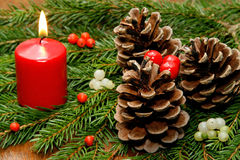 Christmas decoration. With candel and pineals Royalty Free Stock Images