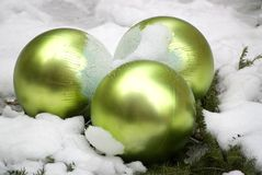 Christmas Decoration. Close-up of green christmas tree decoration balls in snow Stock Photos