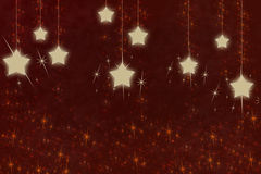 Christmas decoration. Shining stars on a dark red background Royalty Free Stock Photos