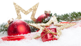 Christmas Decoration. (baubles, stars, gifts) in snow Stock Image