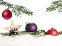 Christmas Decoration. In snow under a branch of a christmas tree Royalty Free Stock Photos