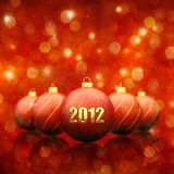 Christmas decoration. Christmas baubles on red sparkly background ,2012 royalty free illustration