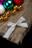 Christmas decoration. And silver bow on black background Stock Images