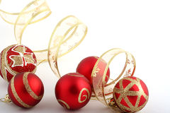 Christmas decoration. With red balls and gold ribbon Royalty Free Stock Photos