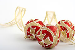 Christmas decoration. With red balls and gold ribbon Stock Photography