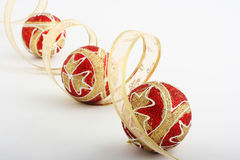 Christmas decoration. With red balls and gold ribbon Royalty Free Stock Photography