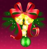 Christmas decoration. Two golden Christmas bells, decorated big red bow, balls and tree Stock Photo