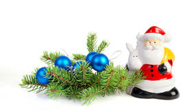 Christmas decoration. Figurine Santa Claus, christmas balls and decoration on fir tree branch royalty free stock photos