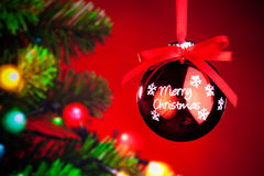 Christmas decoration. Against red background with Christmas-tree Royalty Free Stock Photos