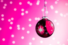 Christmas decoration. Against pink bokeh background Stock Image