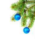 Christmas decoration. Christmas balls and decoration on fir tree branch isolated on white Royalty Free Stock Images