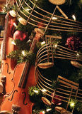 Christmas decoration. With violins and notes Royalty Free Stock Photo