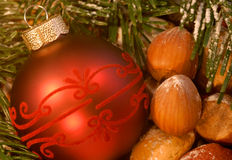Christmas decoration. With bauble and nuts Stock Images