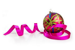 Christmas decoration. Beautiful christmas ball with pink ribbon  on white background Royalty Free Stock Images