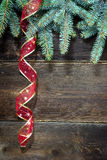 Christmas decoration. Christmas fir tree with ribbon on wooden background Stock Photo