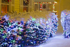 Christmas Decoration. Colorful Christmas Lights outside the houses Stock Photography
