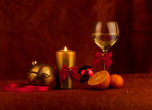 Christmas decoration. Glass with champagne and burning candle stock photos