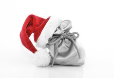Christmas decoration. Silver gift bag with red santa claus hat Royalty Free Stock Image