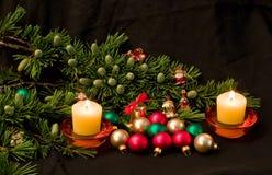 Christmas decoration. Christmas tree, candles, balls and toys Stock Photos