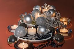 Christmas Decoration. Christmas table decoration with beads, baubles and candles royalty free stock image