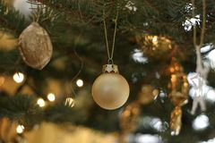 Christmas decoration. Yellow decoration on the christmas tree Royalty Free Stock Photography