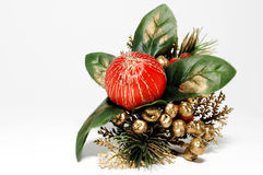 Christmas decoration. With green leafs, red ball and green pine twigs; isolated on white Royalty Free Stock Photos