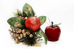 Christmas decoration. With green leafs, red ball, apple and green pine twigs; isolated on white Stock Photo