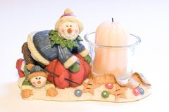 A Christmas decoration. With two snowmen and a candle Stock Photo