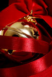 Christmas decoration. Gold christmas decoration with red ribbon Stock Images