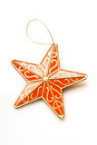 Christmas decoration. Red star christmas decoration isolated over white background Stock Photos