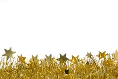 Christmas decoration. White background with golden christmas decoration at the bottom and copyspace Stock Images