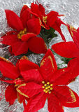 Christmas decoration. Christmas flower decorations on tinsel Royalty Free Stock Image